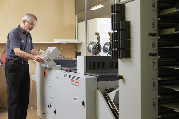 Digital finishing equipment at Advance Press factory