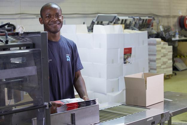 Advance Press bindery staff member at Perth factory