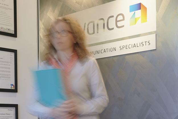 Advance Press sales staff member at Perth office